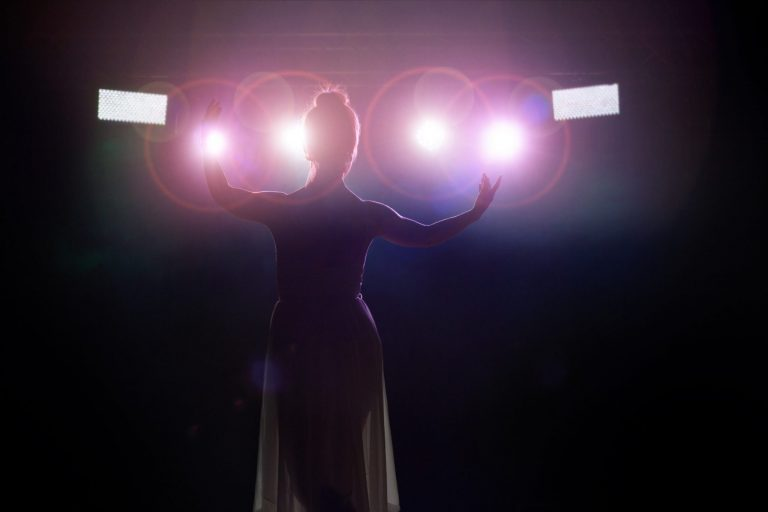 sillouette of a woman singing in a theatre in perth