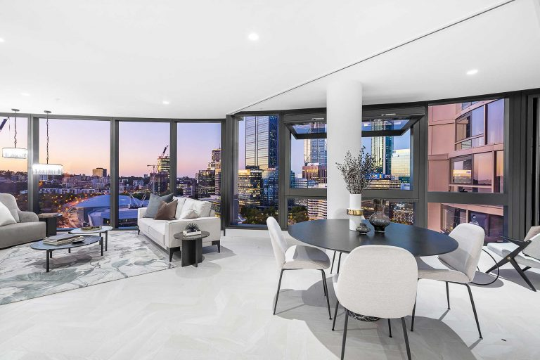 living and dining area from an apartment at the towers perth elizabeth quay